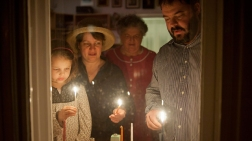 Hungary. EPA. Rabbi Zoltan Radnoti Lights Hanukkah Candles With Family. 2013. Web. 18 Dec. 2014.