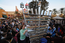 Garcia, Eugene. A hungry crowd gathered to grab a bite from a cupcake menorah after its lighting at Irvine Spectrum Center in Irvine, Calif., Dec. 9. The Chabad of Irvine sponsored the event where hundreds of cupcake. 2012. Web. 18 Dec. 2014.