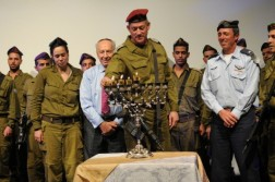 Chief of the General Staff Lt. Gen. Benny Gantz, flanked by President Shimon Peres (left) and IDF Chief Rabbi Brig. Gen. Rafi Peretz (right), lighting a menorah this week Read more: The IDF marches '. 2012. Web. 19 Dec. 2014.