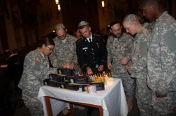 Capt. Mendy Stern, chaplain, second from right, leads soldiers in lighting menorahs at a Hanukkah Ceremony. 2013. Web. 19 Dec. 2014.