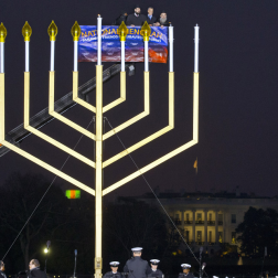 Martin, Jacquelyn. From left in the cherry picker, Rabbi Levi Shemtov, Office of Management and Budget Acting Director Jeffrey Zients and Rabbi Abraham Shemtov lighted the National Hanukkah Menorah on the Ellipse, near. 2012. Web. 18 Dec. 2014.