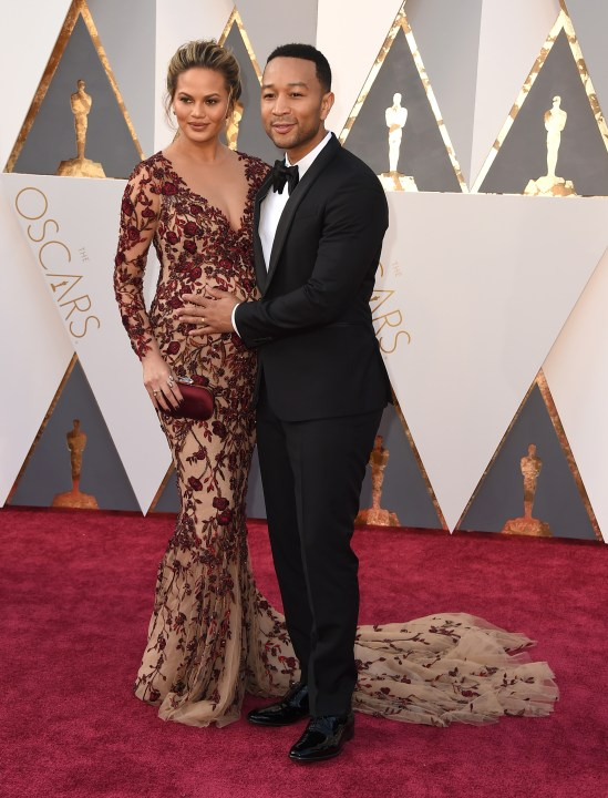 Strauss, Jordan. John Legend in Paul Smith and Chrissy Teigen in Marchesa. 2016. Web. 28 Feb. 2016. http://www.twincities.com/2016/02/28/celebrities-at-the-oscars-dress-to-impress-on-the-red-carpet/.