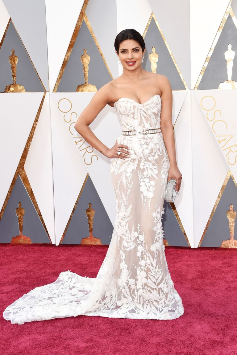 Getty. Priyanka Chopra in Zuhair Murad. 2016. Web. 28 Feb. 2016. http://www.harpersbazaar.com/celebrity/red-carpet-dresses/g6907/oscars-red-carpet-2016/?slide=14.