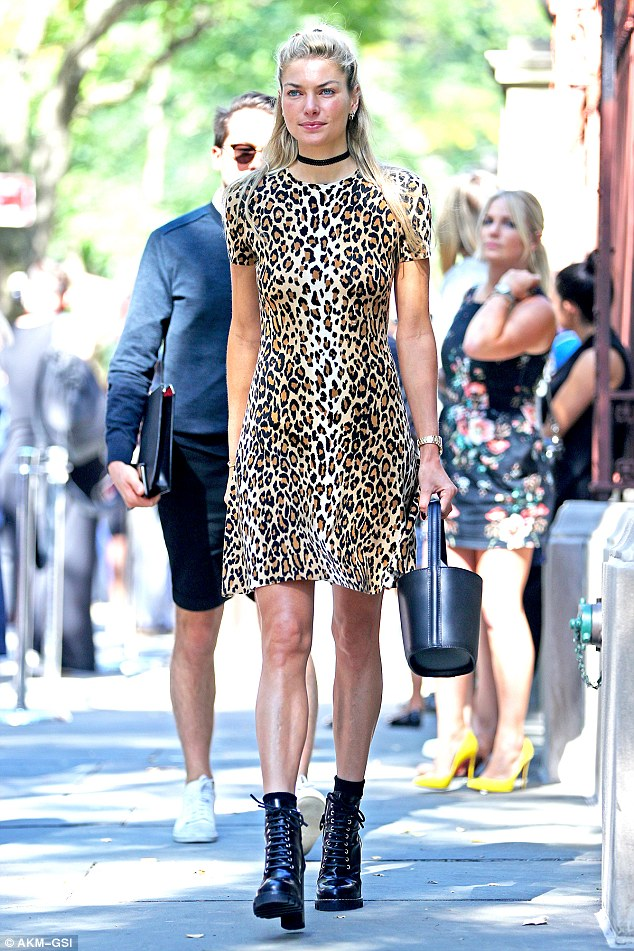 AKM-GSI. Jessica Hart in Carolina Herrera. 2016. Web. 18 Sept. 2016. http://www.dailymail.co.uk/tvshowbiz/article-3786226/Jessica-Hart-looks-lovely-leopard-print-arrives-Carolina-Herrera-New-York-Fashion-Week.html.